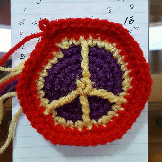 My first effort at designing a peace sign crochet hexagon to be used in a crochet soccer ball