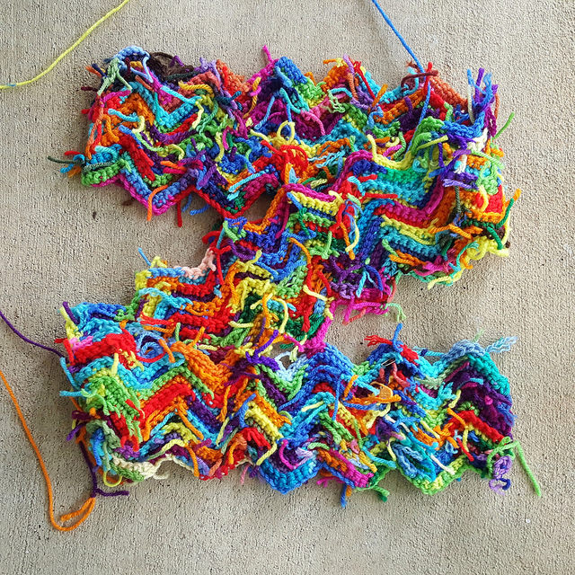 The scrap yarn ripple blanket gets even scrappier with the many yarn scraps I have every where