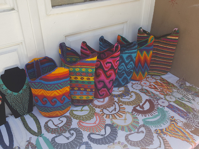 An assortment of crochet bags at the corner of Don Gaspar and San Francisco in Santa Fe, New Mexico