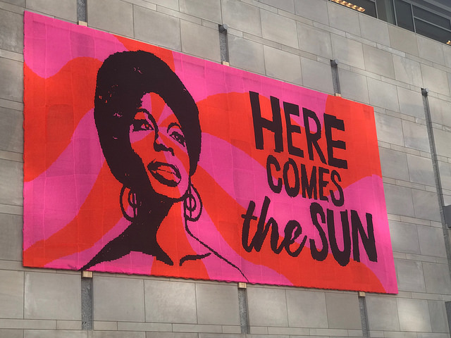 "Nina Simone ""Here comes the sun"" crochet poster at the Raleigh Convention Center"