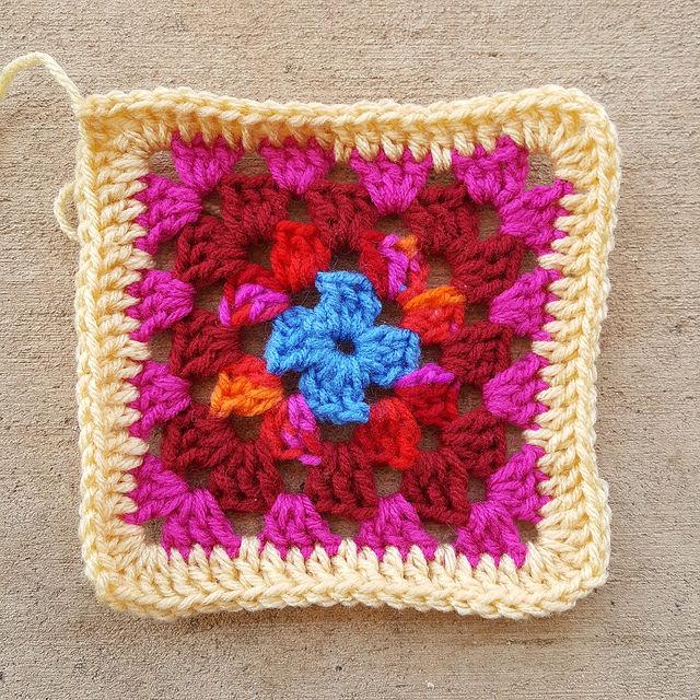 scrap yarn granny square, crochetbug, granny shell, double crochet, scrap yarn crochet square, roseanne, roseanne reboot, sofa afghan, crochet afghan, granny square afghan, granny square blanket, granny square throw