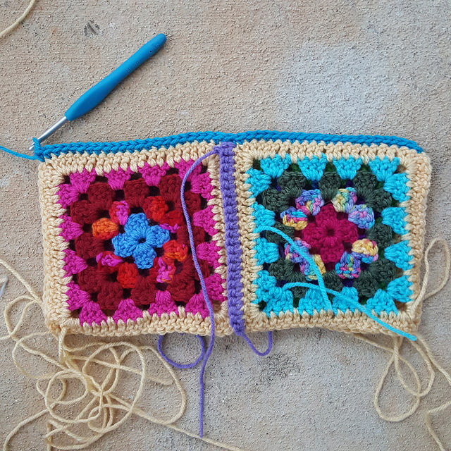 a seam of single crochet stitches joining two sets of two granny squares each