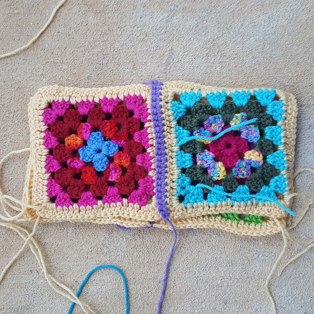 four granny squares in two arrays of two with the right sides together