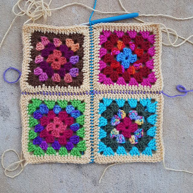 A view of four granny squares joined with single crochet stitches