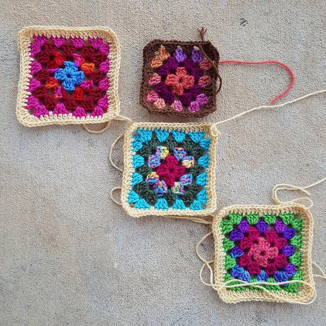 four scrap yarn granny squares