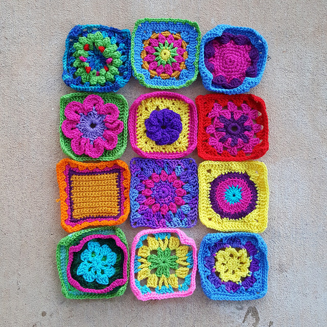 Twelve more crochet squares destined for Project Amigo