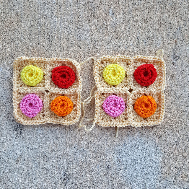 three five-inch crochet squares made from crochet rose granny squares