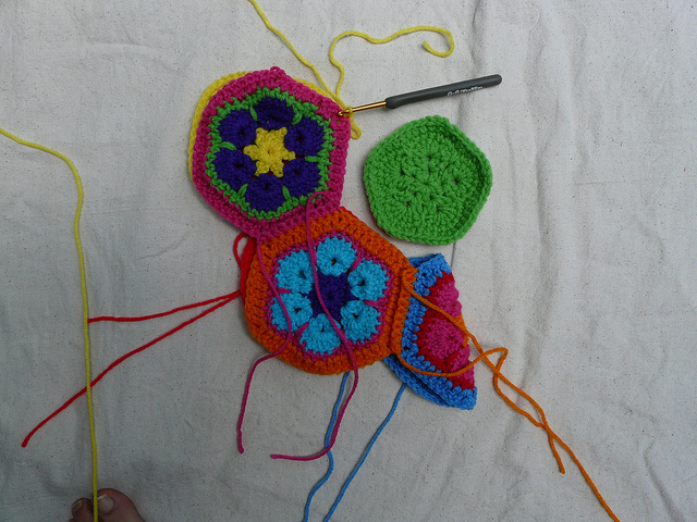 crocheting the fifth seam or a panel of crochet hexagons