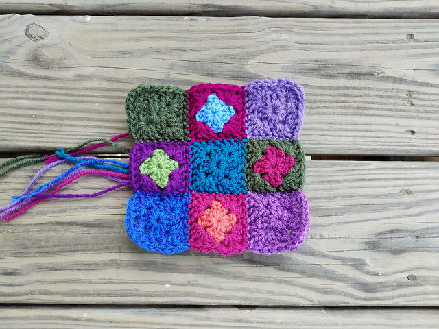 a nine patch of two round granny squares