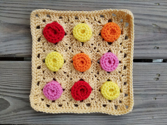 An eight-inch, nine-patch crochet rose granny square ready in plenty of time to meet the crochet deadline