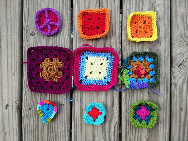 a nine patch of crochet remnants with two crochet squares rehabbed