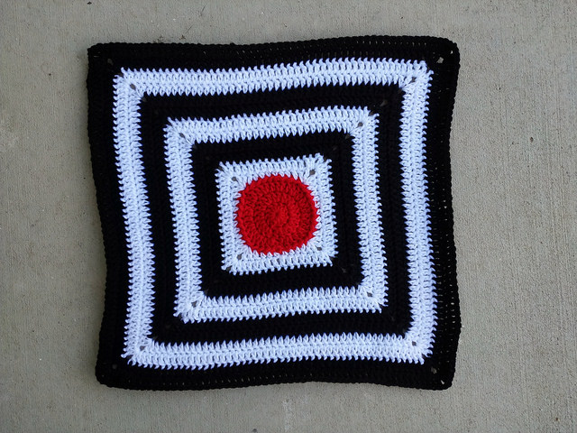 a crochet circle centered granny square baby blanket