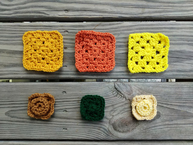 Six crochet remnants ready to be rehabbed into five-inch crochet squares