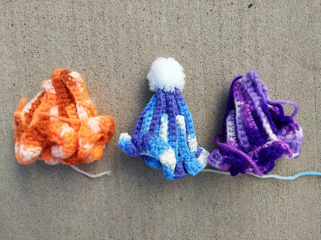Three textured, ruffled crochet pieces made with variegated yarn