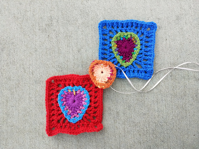 I get back on the road to a thousand crochet squares with two more crochet heart squares and  the center of a future motif