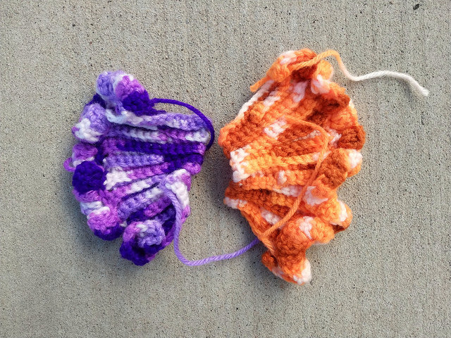two textured ruffled crochet pieces made with variegated yarn
