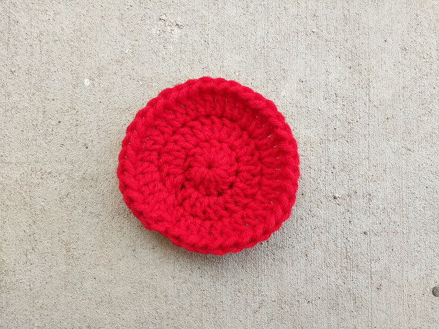 A double crochet circle with the ends woven in as if on a painted ocean