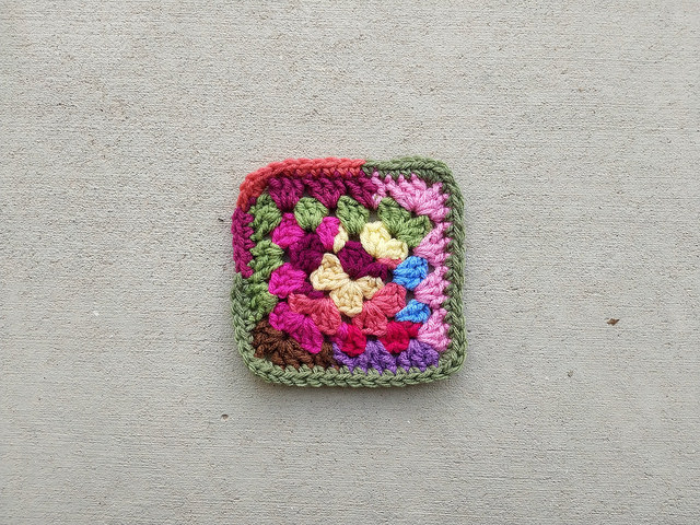 A five-inch scrap yarn granny square