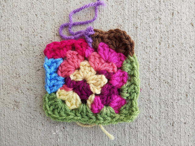 An unfinished scrap yarn granny square I found while sorting