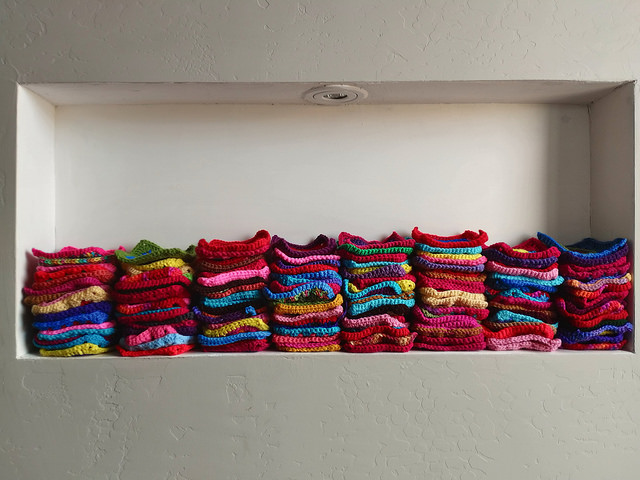 filling the wall nook with crochet squares
