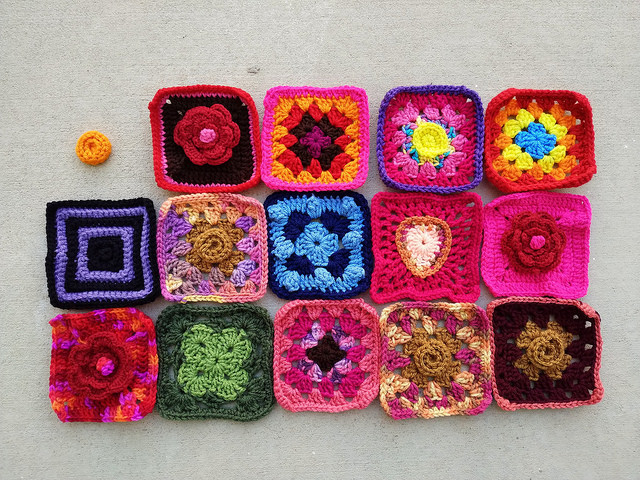 Fourteen rehabbed crochet squares and a crochet remnant waiting in the wings