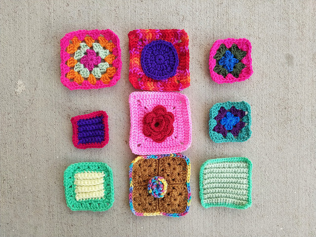 Nine crochet remnants with the ends woven in and the first round of crochet transformation
