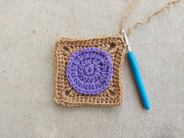 The crochet square frogged and with the second round of double crochet reworked with half double crochet stitches