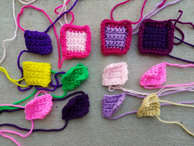 Twelve crochet remnants waiting to become five-inch crochet squares
