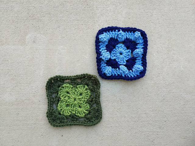 two five-inch crochet squares, one green and one blue