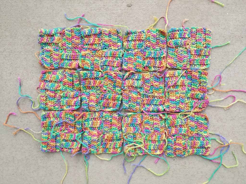 Twelve four patch crochet squares ready for a crochet border