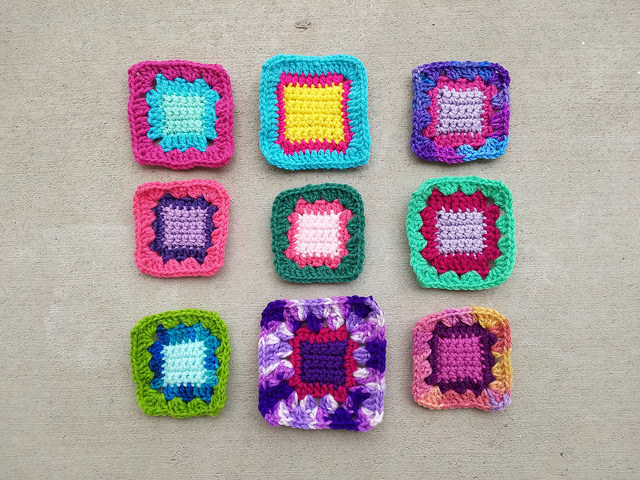 A nine-patch of crochet squares ready for a third round of crochet rehab