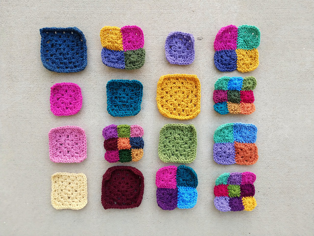 Sixteen future five-inch rehabbed crochet squares with the ends woven in