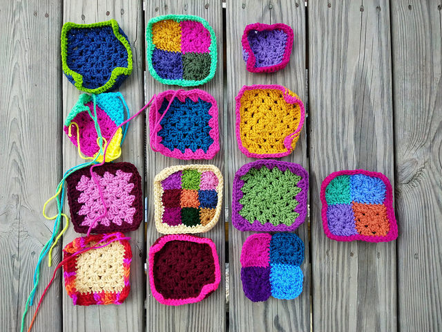 Thirteen of sixteen crochet remnants becoming five-inch crochet squares
