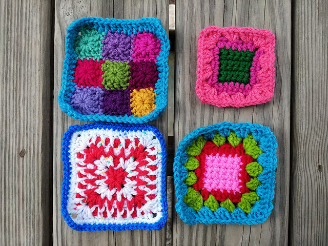 Three more five-inch crochet squares and a fourth nearly completion]