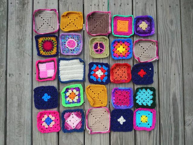 Twenty-five rehabbed crochet squares ready for adventure
