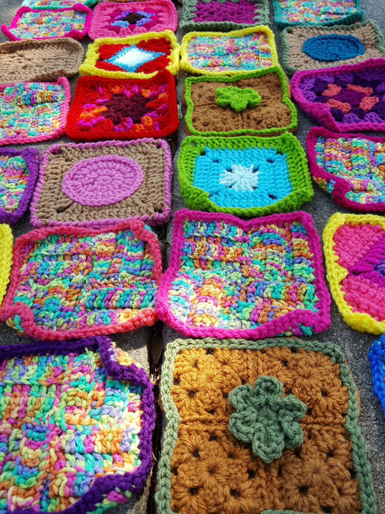 A detail of a few of the thirty-two rehabbed crochet squares