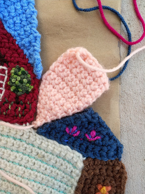 A crochet crazy quilt piece that almost fits