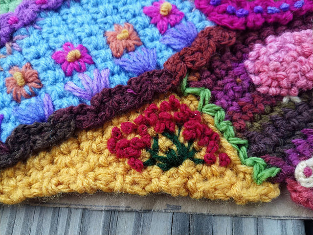 A detail of modest progress on a crochet crazy quilt piece