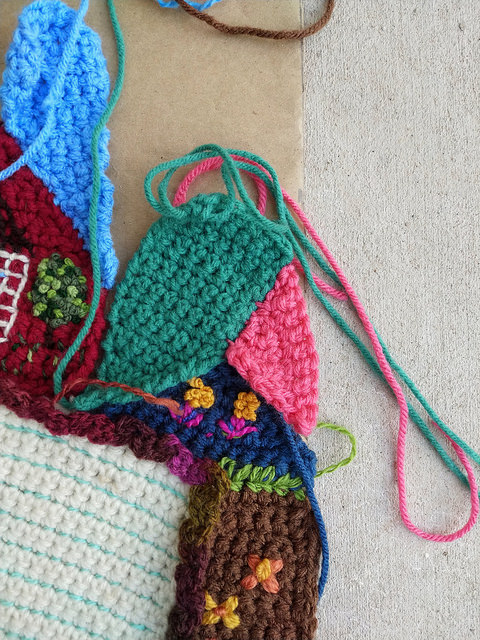 I seam one edge of two newly completed crochet crazy quilt pieces