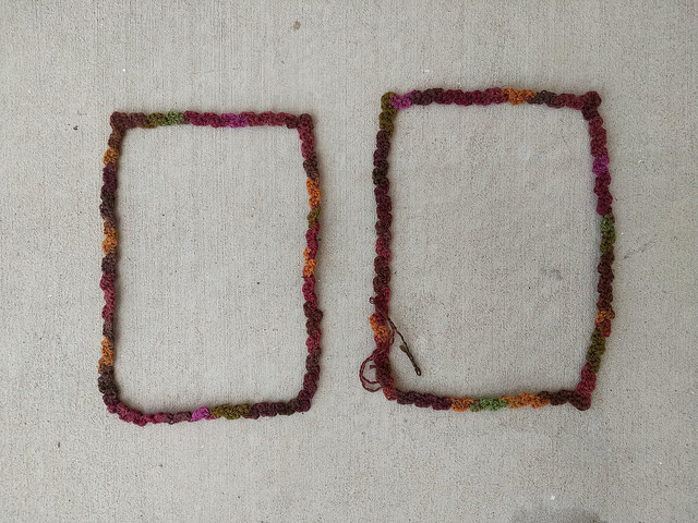 The two cherry cola crochet rickrack frames with most of the ends woven in