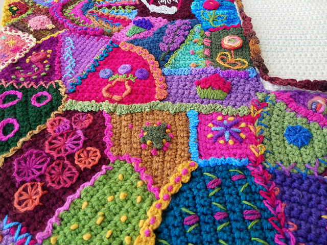 A detail of the tricking out and seaming of the crochet crazy quilt panel