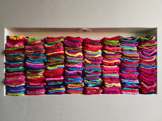 A nearly full nook of rehabbed five-inch crochet squares from my fevered crochet imagination