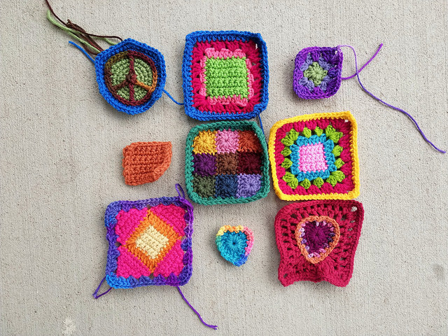 A nine patch of crochet remnants mid-transformation