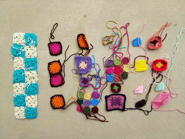 An array of crochet remnants that demonstrate the truth that a crocheter's work is never done