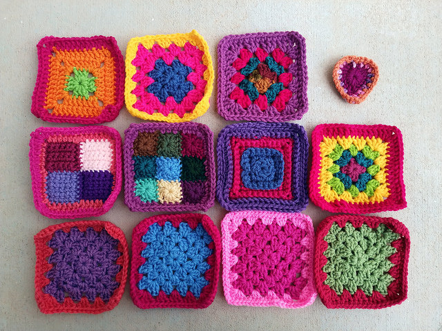 Eleven rehabbed crochet remnants and a boho heart waiting in the wings
