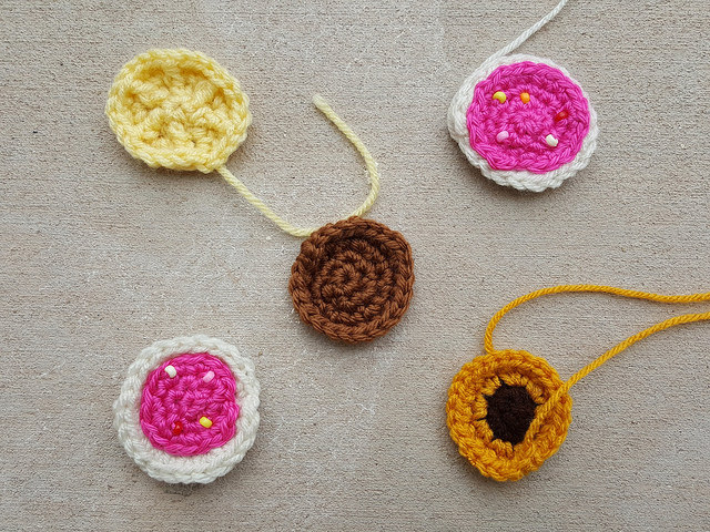 Five small crochet cookies from my 2013 State Fair project in need of documenting