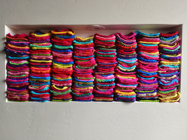 The nook filled nearly to the brim with crochet squares