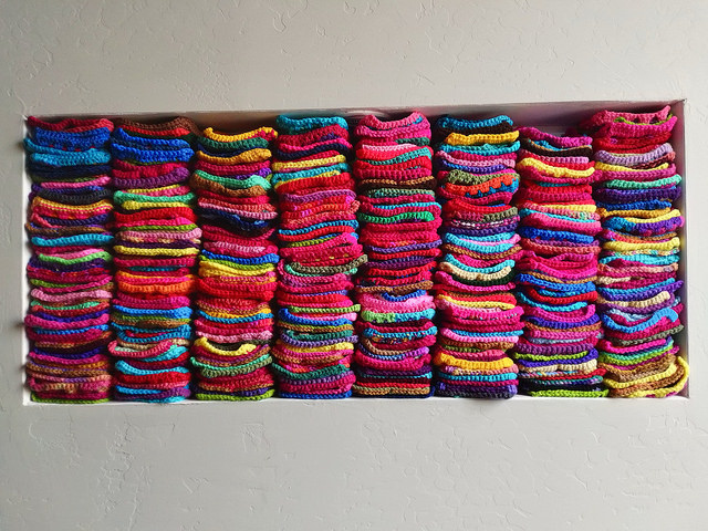 The nook filled to the top with five-inch crochet squares
