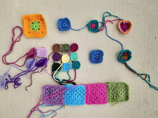 Twelve crochet remnants from the slimmer pickings awaiting transformation
