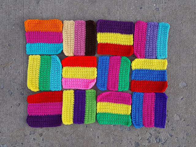 A dozen six-inch rehabbed crochet squares to be